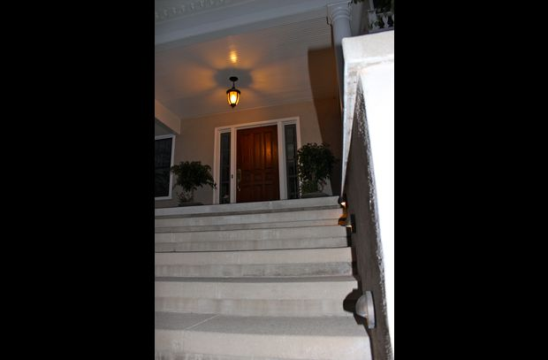 Front stair case with area lighting.